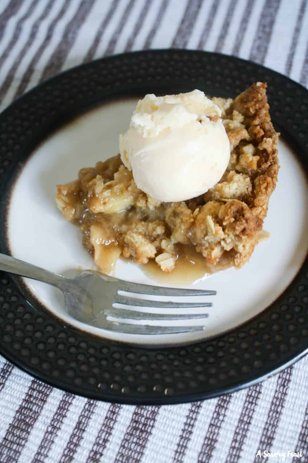 This Caramel Dutch Apple Pie is an update on an old classic. I used my favorite dutch apple pie recipe and added a homemade caramel sauce.