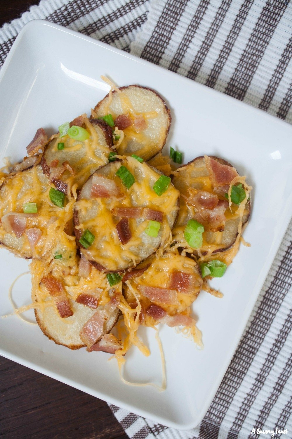 These savory Baked Potato Nachos are a crowd favorite on game day!