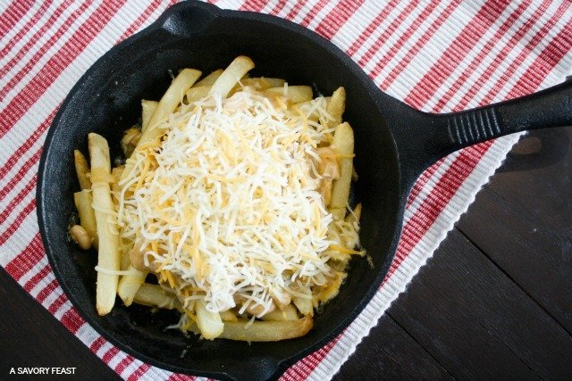 Skillet White Chicken Chili Cheese Fries // This crave-worthy appetizer is sure to be a hit on game day!
