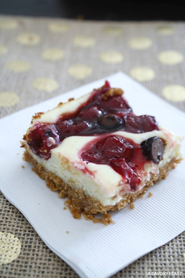Chocolate Cherry Cheesecake Bars // This is the world's easiest cheesecake recipe! Topped with juicy cherries and rich dark chocolate.