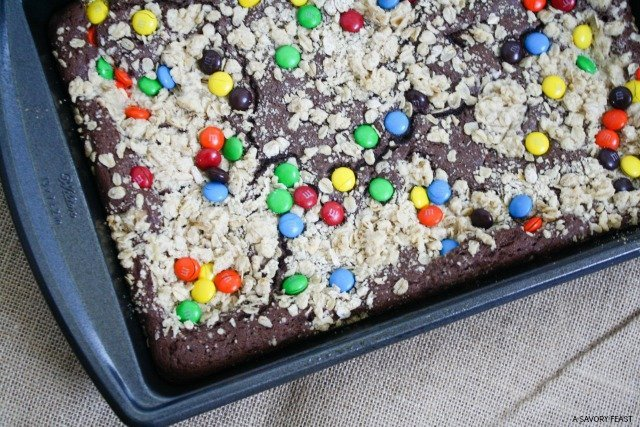 "Just call these ""the ultimate cookie!"" Chocolate cookies made from a cake mix topped with an oat crumble and M&M's candy!"