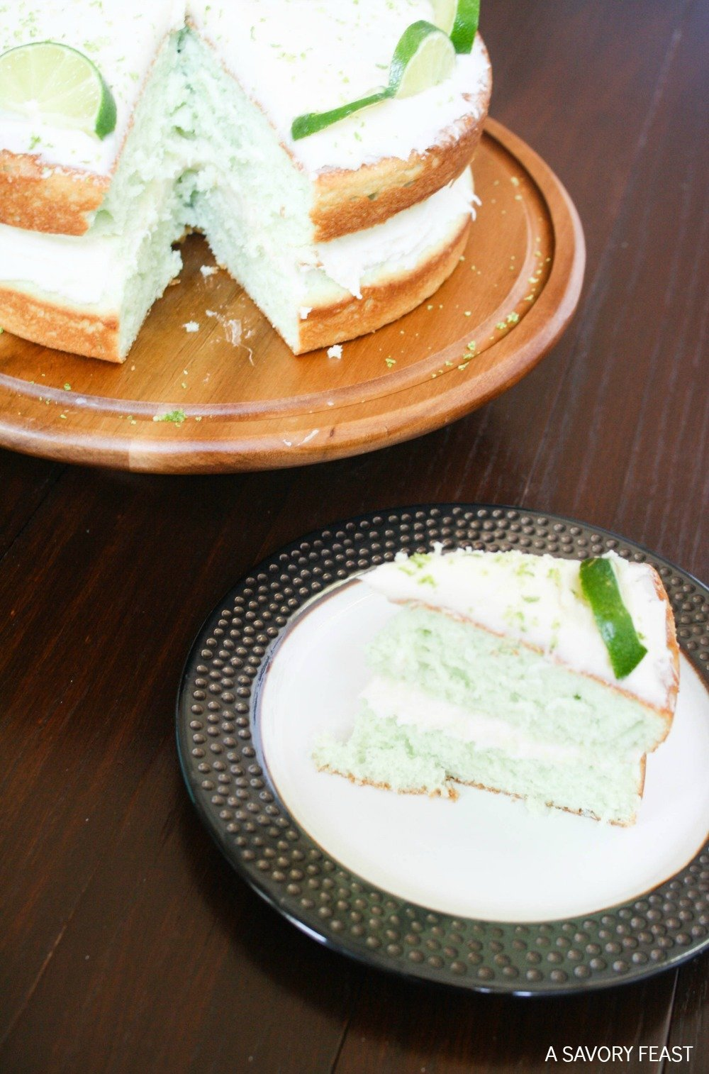You've got to try this refreshing layer cake this summer! This Key Lime Layer Cake is made from scratch with a secret ingredient to give it a pretty lime color!