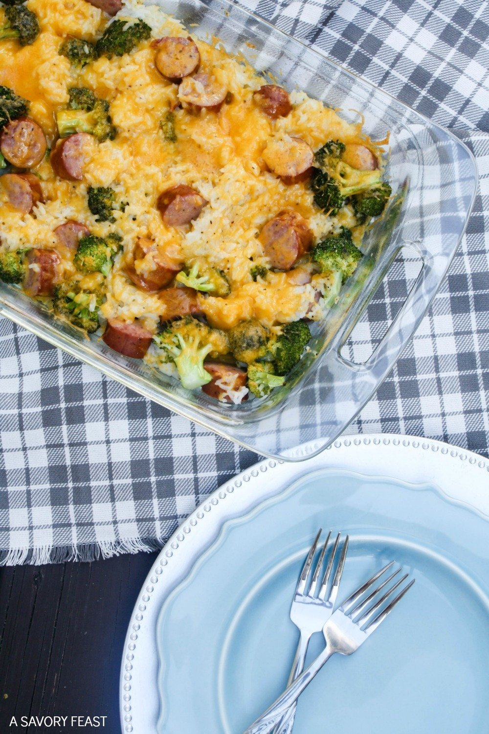 Make dinner easier with this Cheesy Broccoli, Sausage and Rice Casserole. Throw it together in minutes and have dinner on the table in about 30 minutes! This one dish dinner recipe is sure to be a hit with your family.