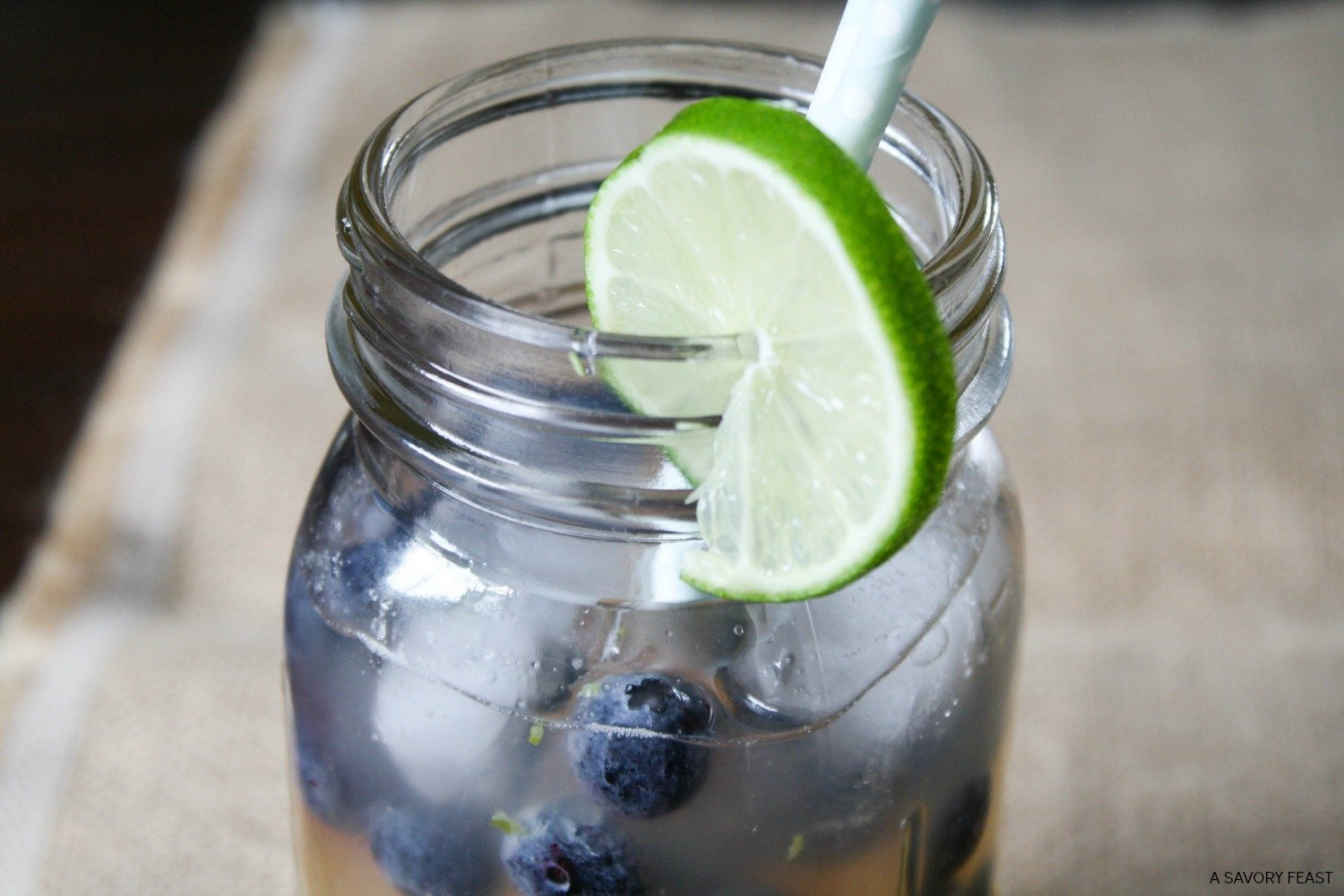Nothing beats an ice cold fruity drink on a hot summer day! Try this healthier take on a limeade. It's sweetened with honey instead of sugar! Tart and flavorful, this drink is made with fresh squeezed lime juice and garnished with frozen blueberries!