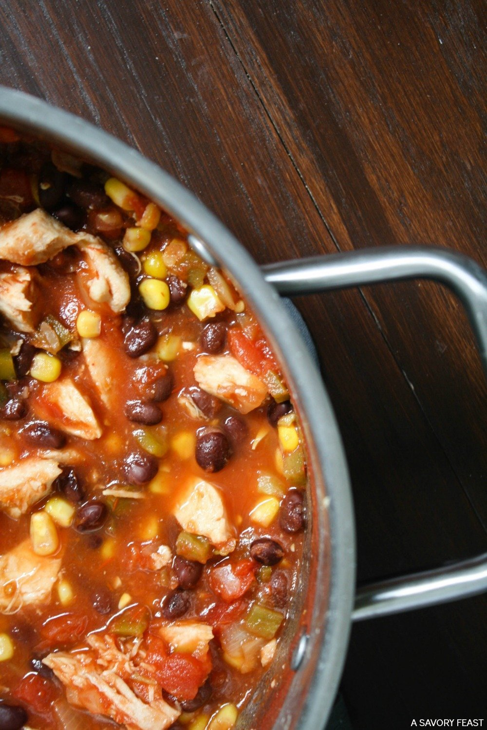 Dinner so easy, it's almost cheating! Mexican Fiesta Soup takes just minutes to throw together and is ready in under 30 minutes. Packed with flavor and filling ingredients like chicken, black beans, salsa and more. You'll love it for a busy weeknight meal!