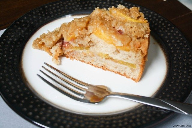 Breakfast is better with a sweet treat like this Peach Streusel Coffee Cake! Fresh peaches layered with cinnamon coffee cake and a crunchy streusel topping. Just the thing for a weekend breakfast or brunch!