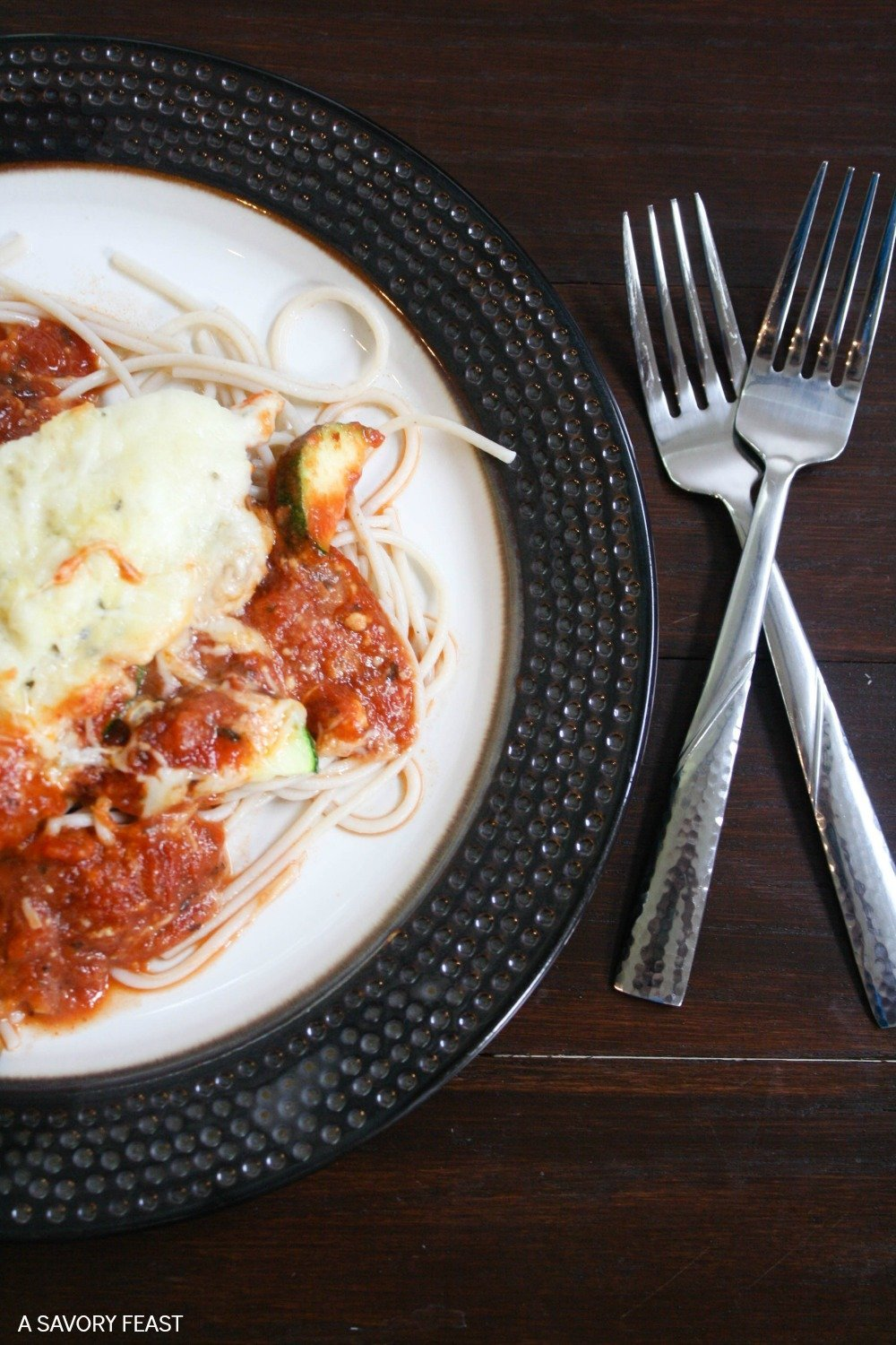 This simple dinner idea is a great way to sneak more veggies into your diet! Less than 10 minutes of prep time are needed to throw this dinner together, and it's ready to eat about 30 minutes later. This update on the classic Chicken Parmesan is one the whole family will love!