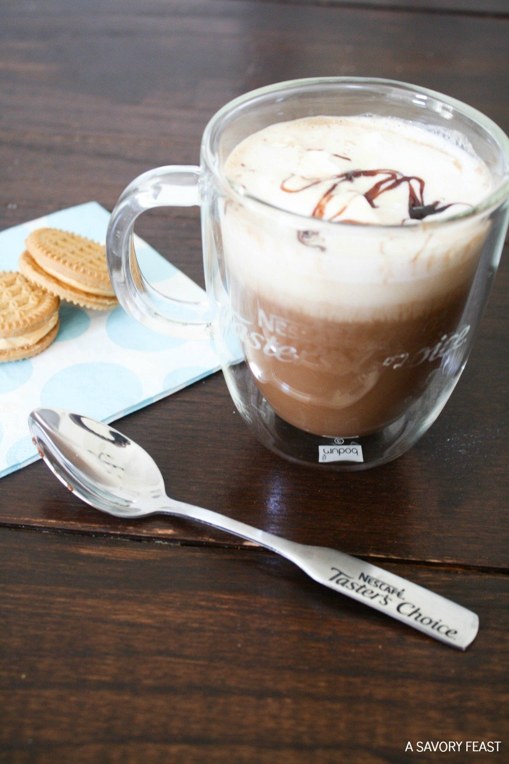 Making your own coffee shop quality drink at home is simple! This Almond Milk Mocha is made in minutes with instant coffee and a few other ingredients you probably have in the house! Dress it up with whipped cream and chocolate drizzle.