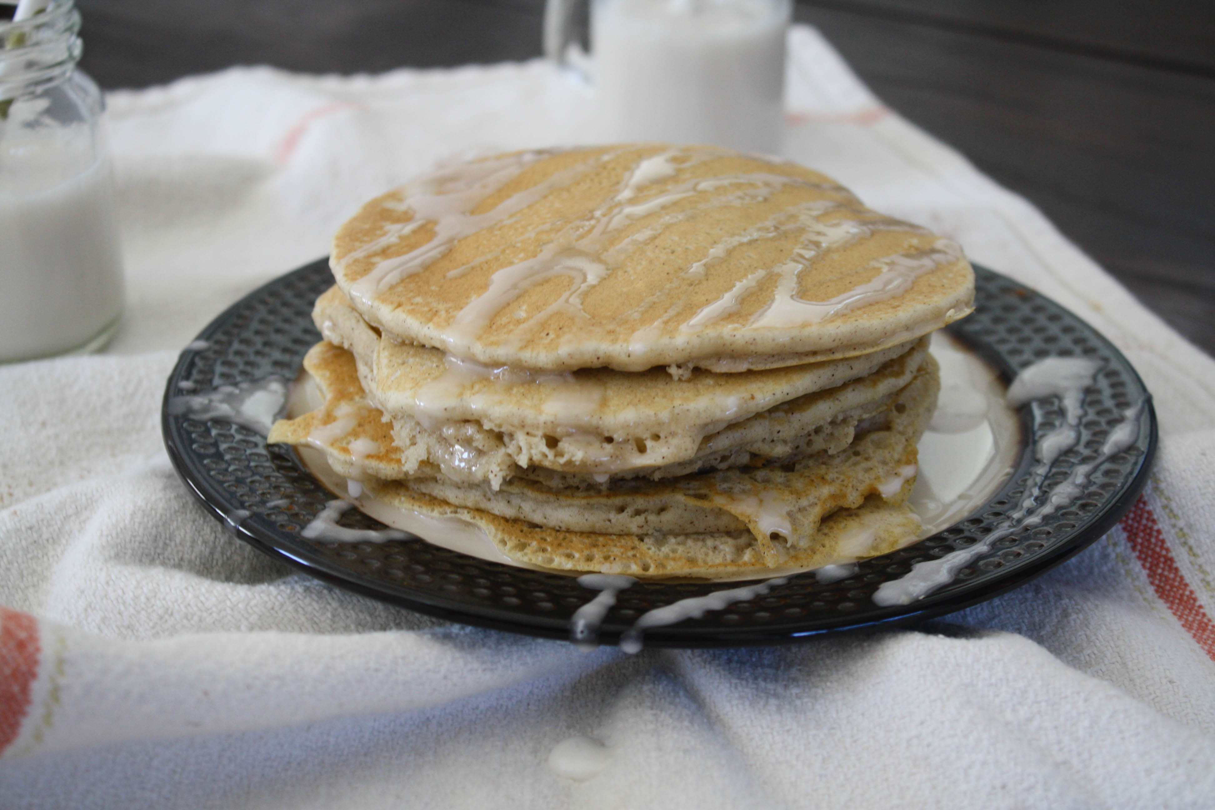 Start your weekend off right with these delicious Cinnamon Pancakes with Icing. If you've never made pancakes from scratch before, you won't believe how easy it is.