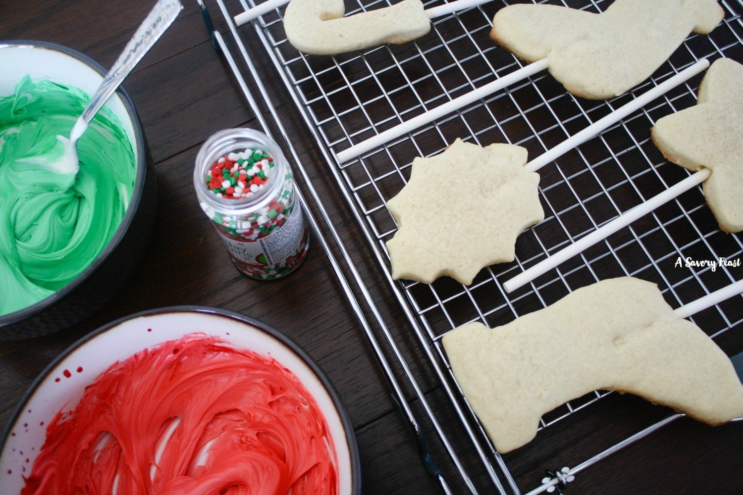 What's better than Christmas cookies? Christmas Cookie Pops, of course! A soft sugar cookie baked from scratch, topped with your favorite frosting and sprinkles. These make great gifts! Perfect for making and decorating with kids.