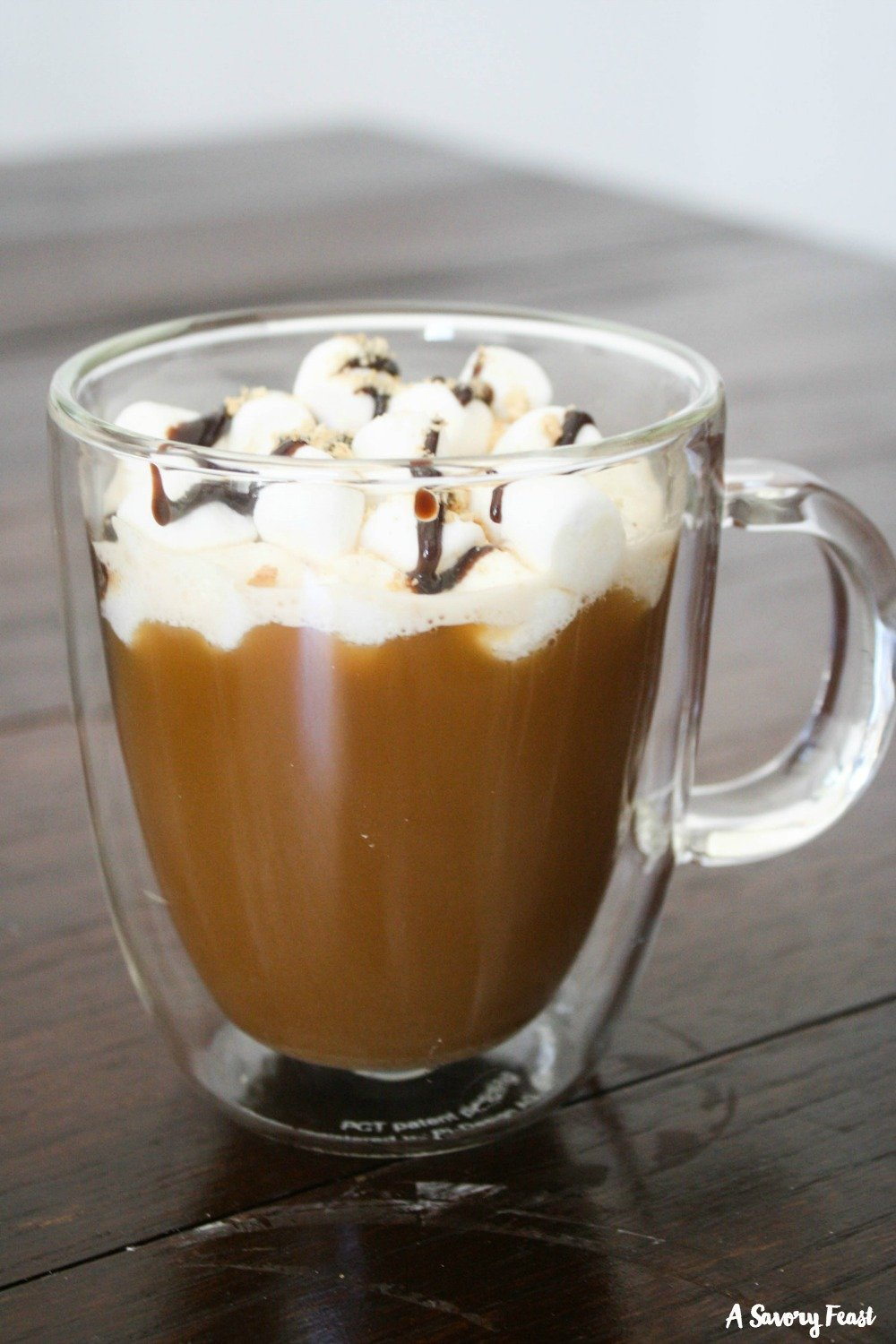 Make this beautiful yet simple S'mores Latte at home! Start with instant coffee and add in a few ingredients to make this coffee house drink at home.