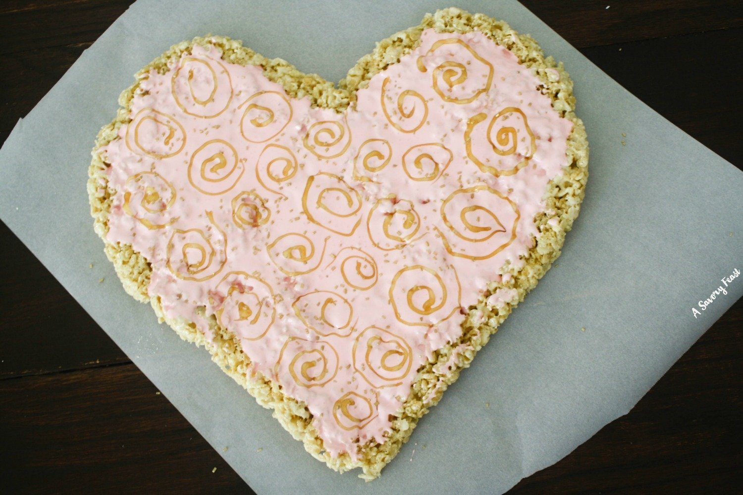 Treat someone special to this beautiful Valentine's Day Rice Krispies Treat Heart! It's a fun treat that is so easy to make. The classic Rice Krispies Treat recipe gets a romantic upgrade for the holiday. | Rice Krispies Treat Ideas | Rice Krispie Treat | Valentine's Day Dessert | Valentine's Day Treat
