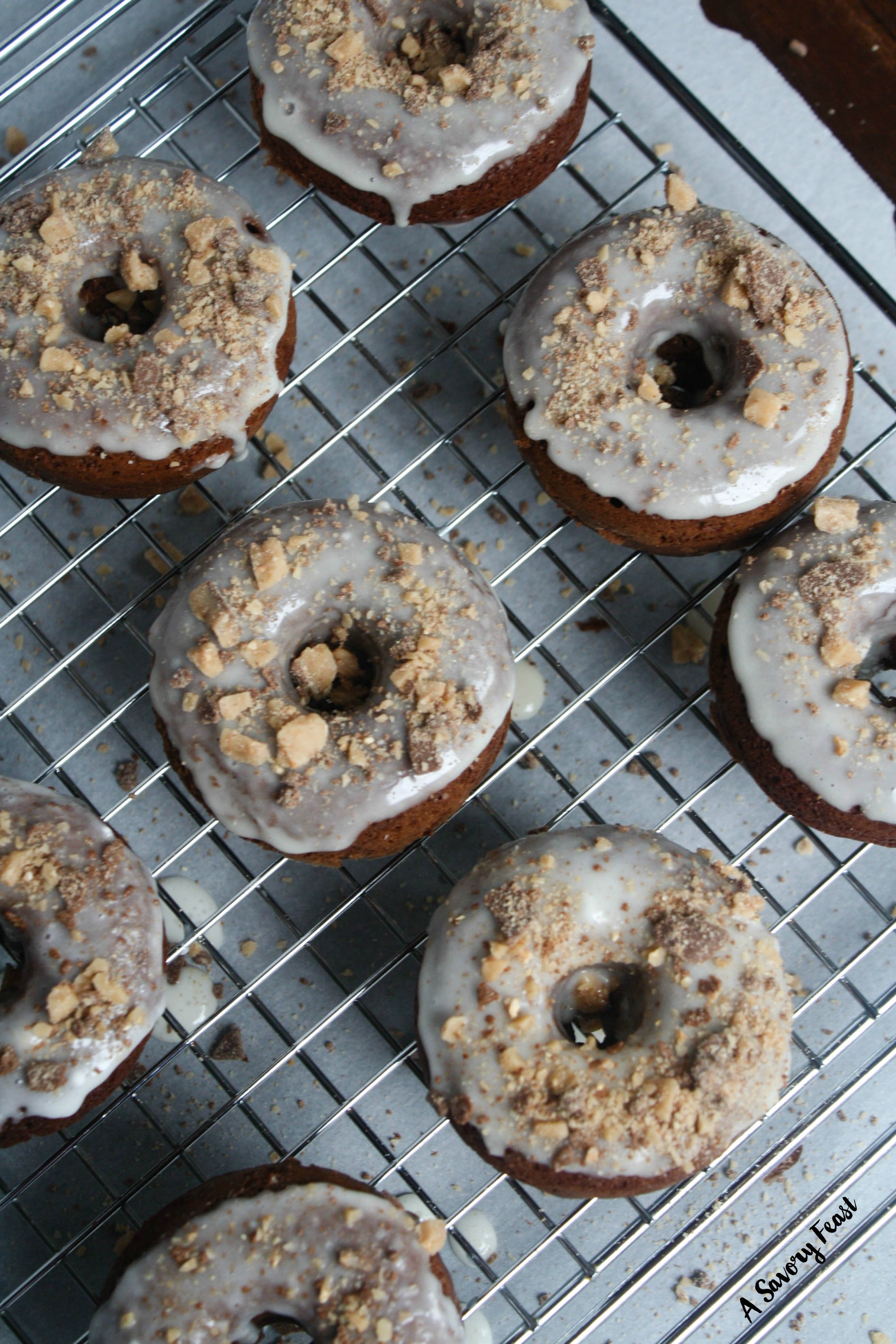 Because we all need more than one form of coffee for breakfast... These Toffee Chocolate Baked Donuts are a delicious coffee-infused chocolate treat! A simple chocolate coffee baked donut dipped in a sugar-y glaze and topped with toffee bits.