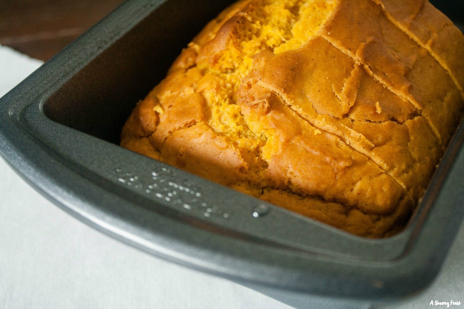 Enjoy a warm slice of this pumpkin bread with a cup of coffee!