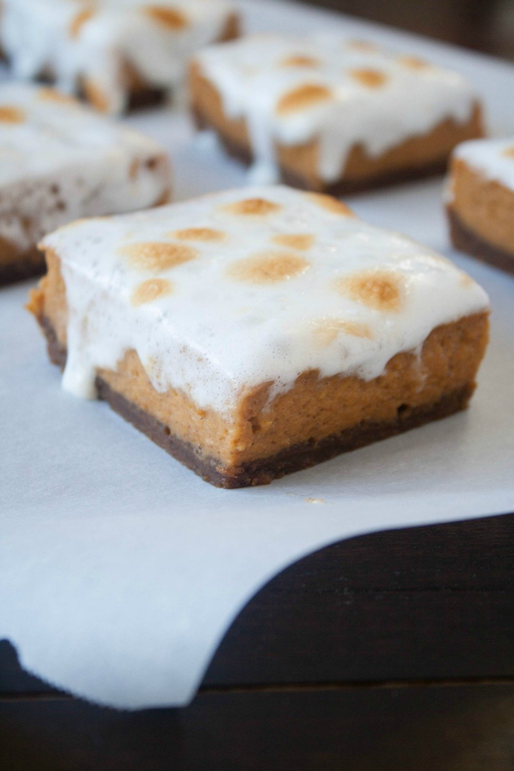 Put a new spin on pumpkin pie this Fall! This dessert features the flavor of pumpkin pie in bar form, with a flavorful gingersnap crust. And on the top, some toasted marshmallows!