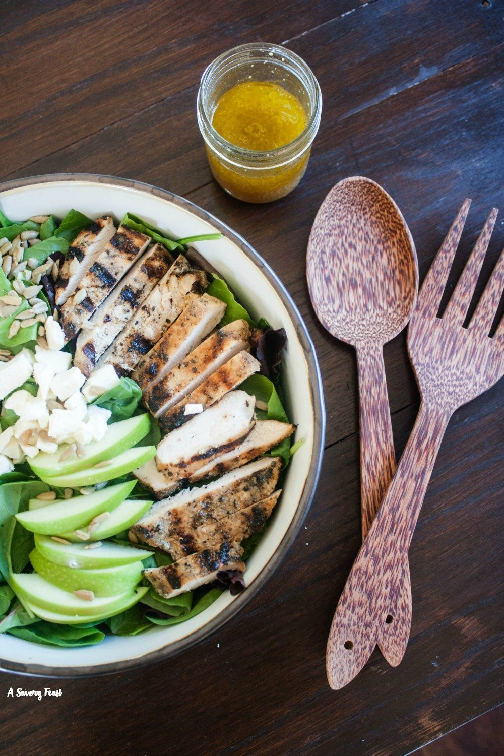 Make this fresh, flavorful Fall salad for dinner tonight! Grilled Chicken and Apple Salad is a snap to throw together and features a homemade apple vinaigrette dressing.
