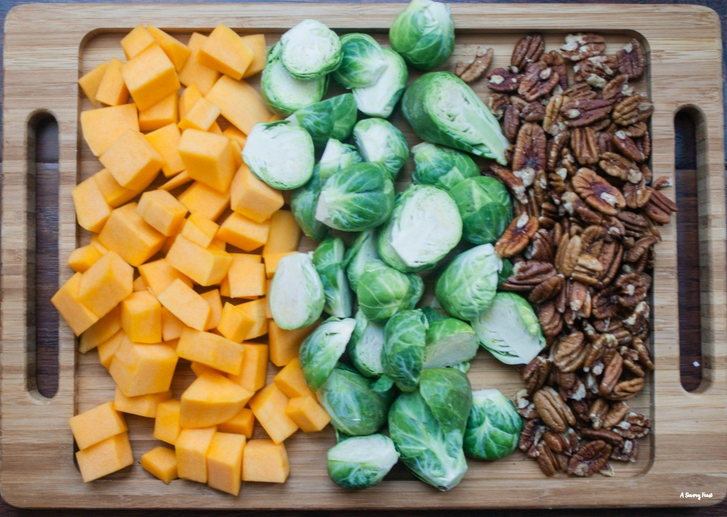 Healthy dinner idea with butternut squash, brussels sprouts and pecans.