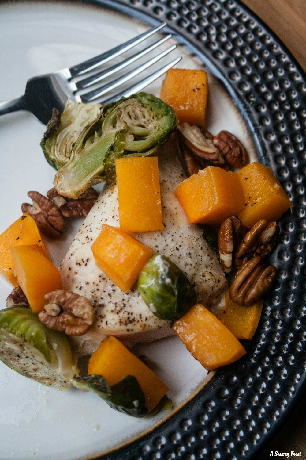 What should I make for dinner tonight? This One Pan Honey Pecan Chicken with Butternut Squash and Brussels Sprouts sounds amazing!
