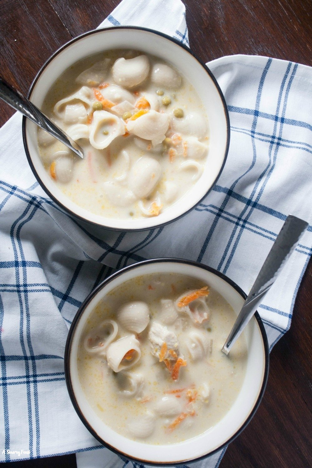 Warm up with this Creamy Chicken Noodle Soup! A flavorful chicken soup with a bit of heavy cream added in. Loaded up with lots of veggies and noodles for a hearty meal.