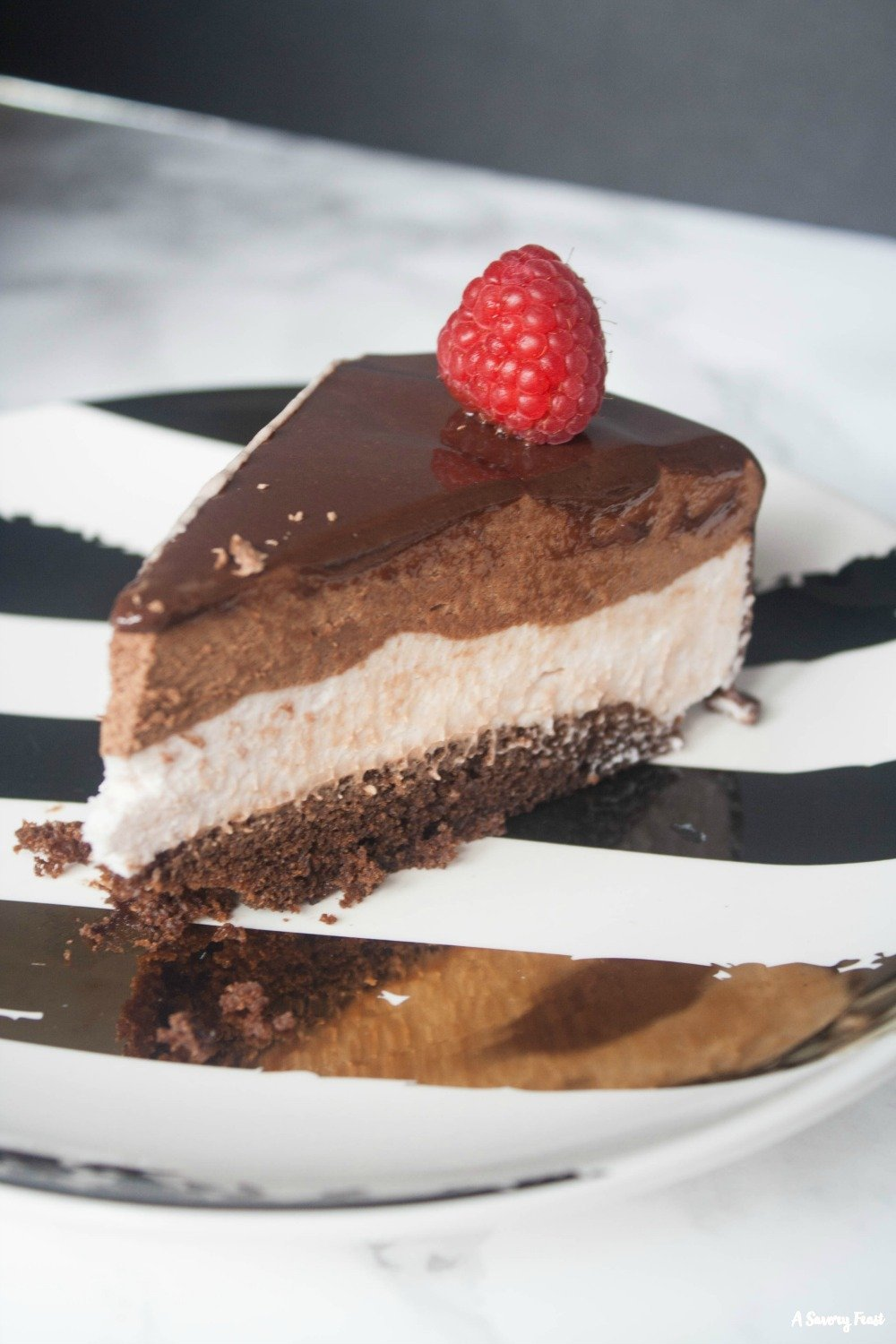 Want to WOW your friends? Make this Raspberry Chocolate Mousse Cake with Mirror Glaze.