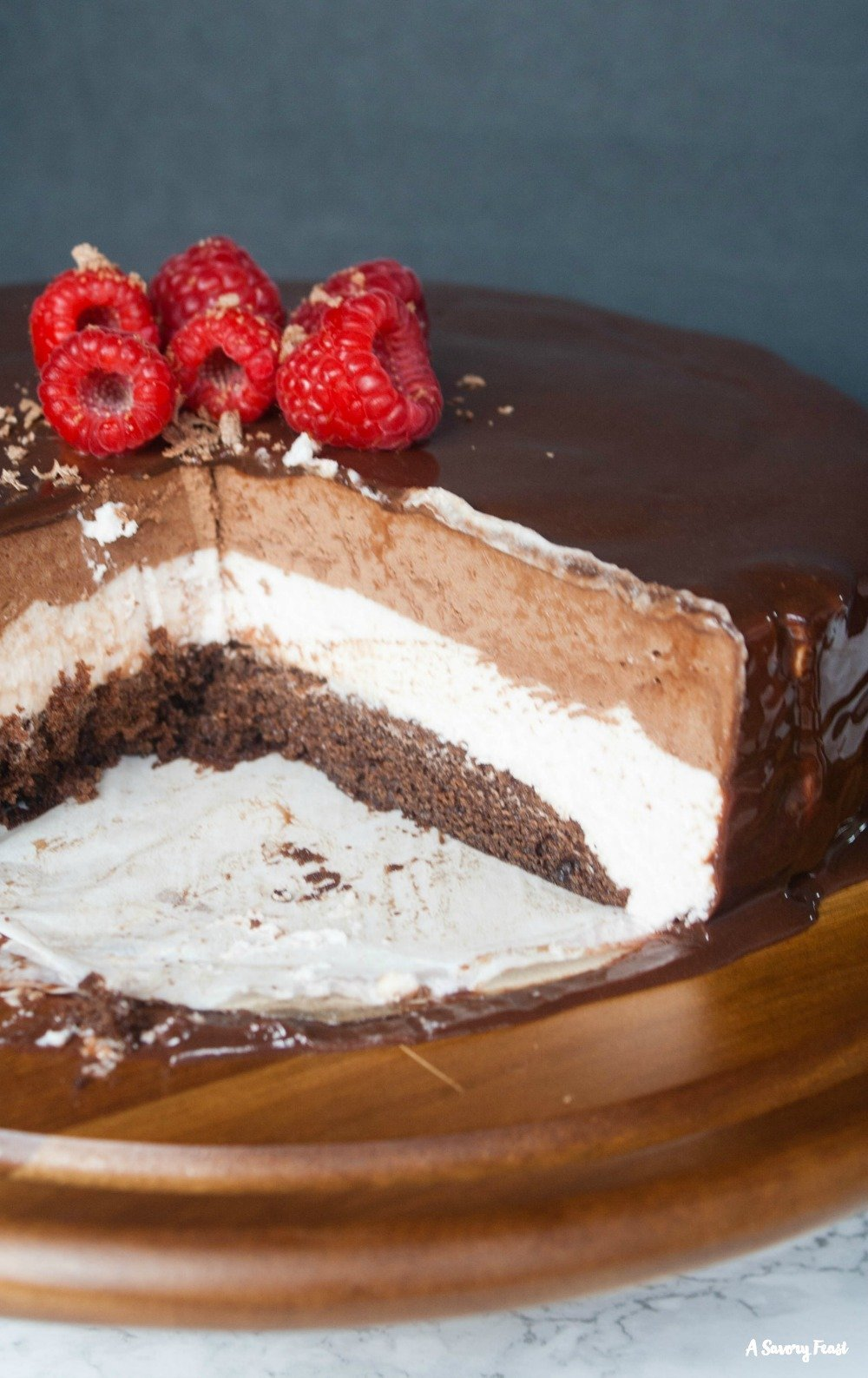 Impress your guests with this Raspberry Chocolate Mousse Cake with Mirror Glaze
