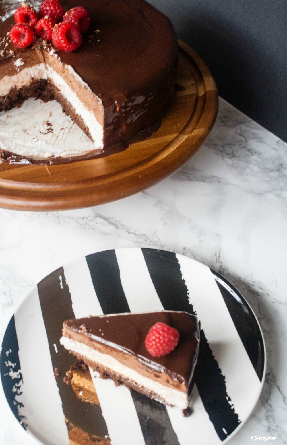 Need a fancy dessert for a party? Raspberry Chocolate Mousse Cake with Mirror Glaze