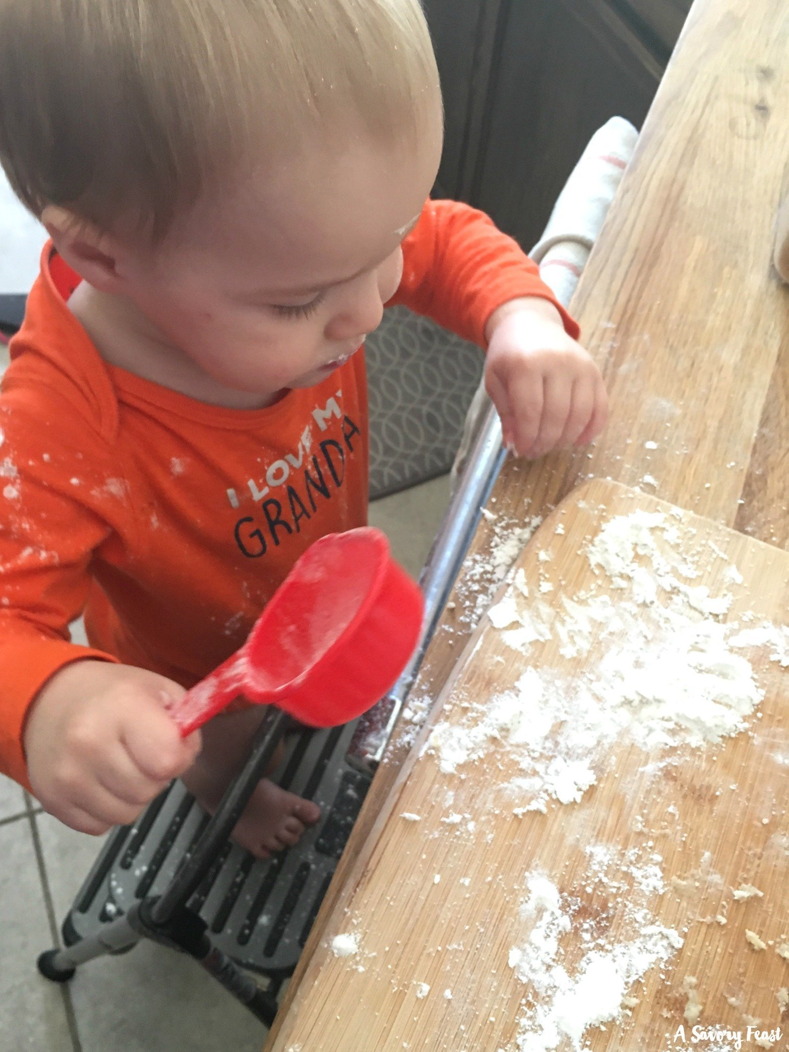 Toddlers can get involved in the kitchen to help make homemade snacks.