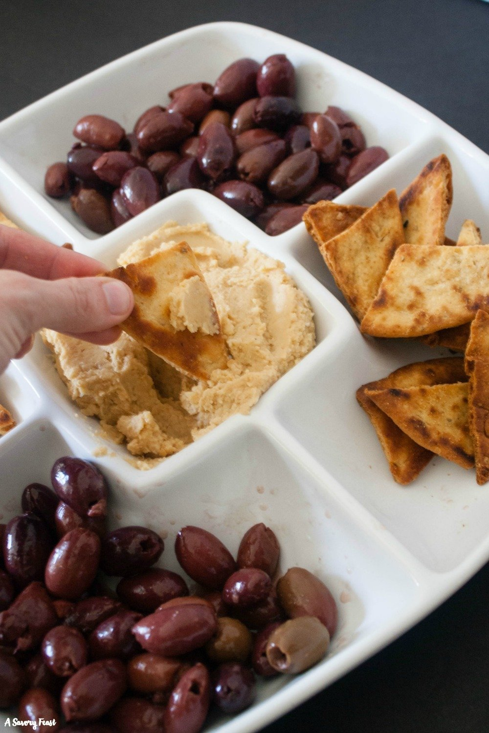 Need a simple, semi-homemade appetizer idea for Easter? Your guests will love this Hummus and Olives Appetizer Tray!