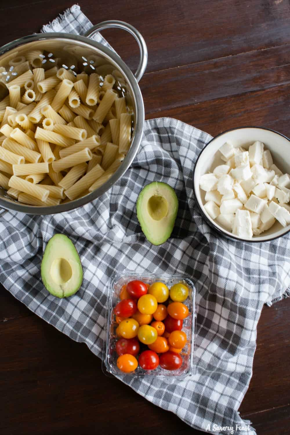 Fresh ingredients for a Summer Tomato and Avocado Pasta Salad.