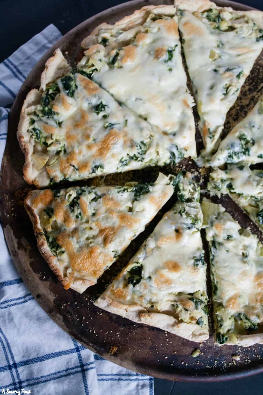 Homemade pizza night just got even better with thisChicken, Spinach & Artichoke Pizza. This new twist on spinach and artichoke dip puts it in pizza form with chicken to make it a complete meal.