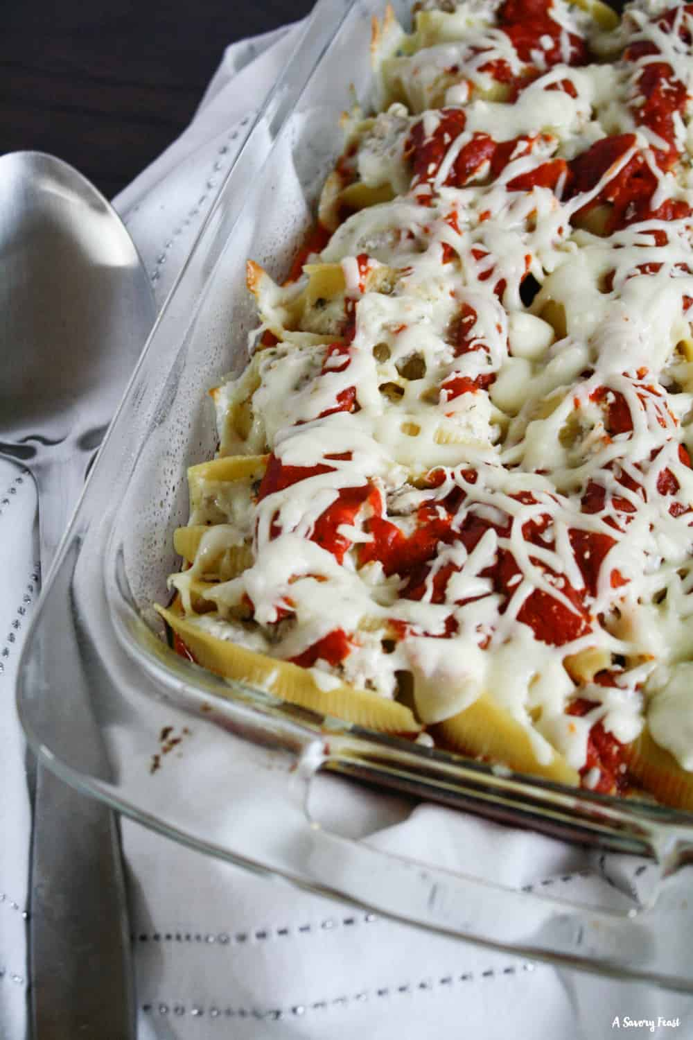 Italian Ground Turkey Stuffed Shells are a delicious option for a weeknight meal, entertaining or freezer meals. Made with ground turkey instead of beef and packed with flavor! Stuffed shells are the ultimate comfort meal.