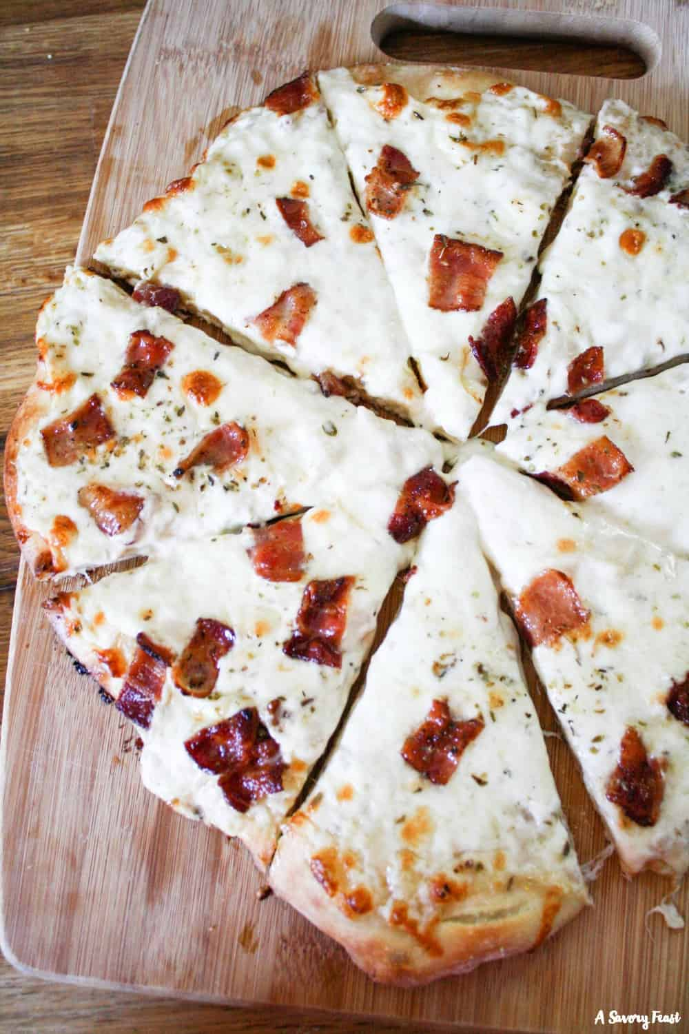 Make it a homemade pizza night with this Bacon Alfredo Pizza! Use your favorite pizza dough and top with alfredo sauce, mozzarella cheese and bacon.