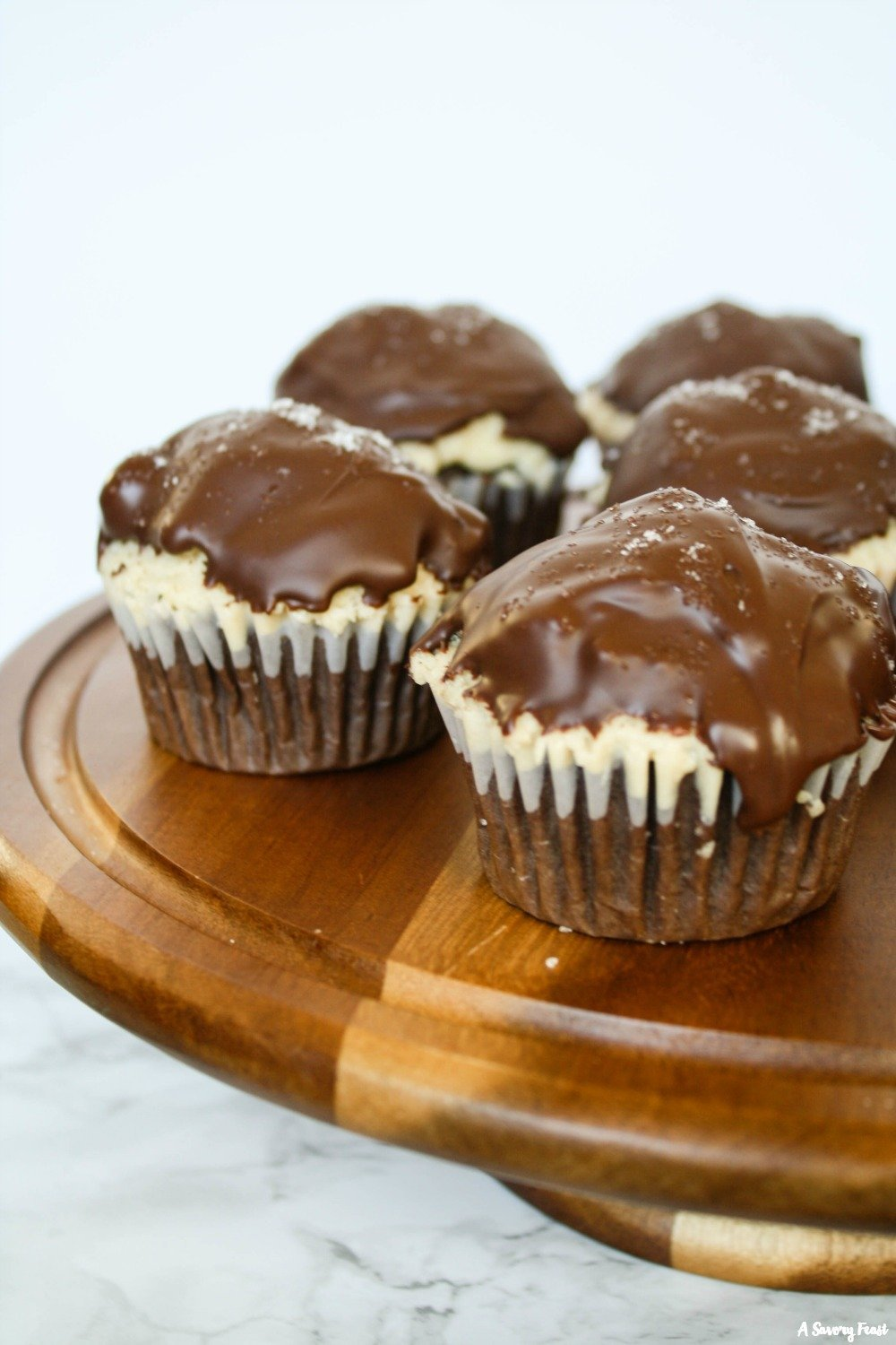 Salted Caramel Chocolate Dipped Cupcakes are a gorgeous dessert for any party.