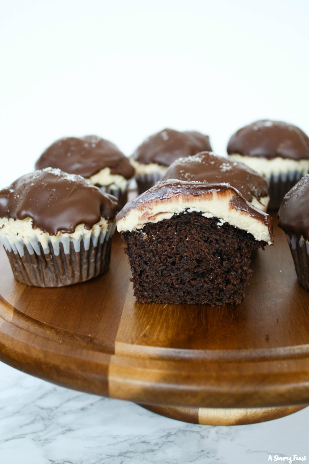 Dress up a boxed cake mix with this Salted Caramel Chocolate Dipped Cupcakes recipe.