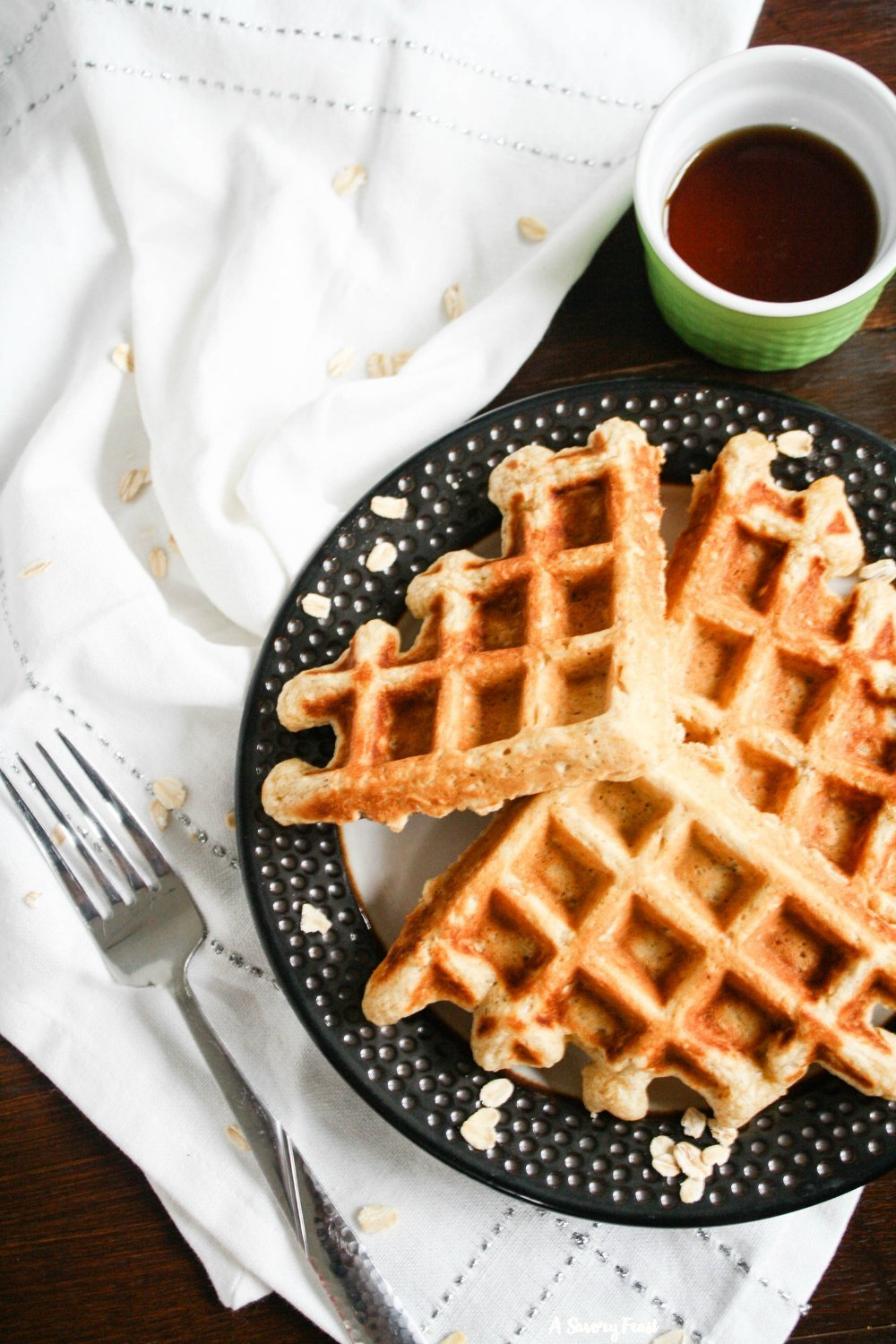 Hearty Oatmeal Waffles are a wonderful start to your weekend. This waffle batter is simple to mix up with ingredients you probably have in the house. You'll love the flavor and texture of these delicious waffles.
