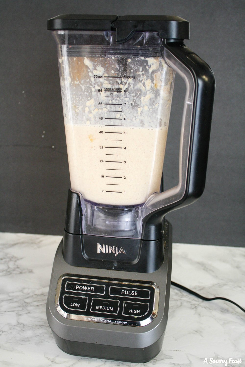 Using a blender to make waffle batter.