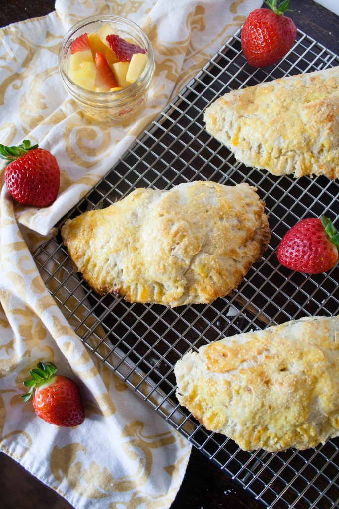 Strawberry Peach Hand Pies are a sweet, rustic dessert that is perfect for Spring! Homemade pie crust wrapped around a juicy filling of peaches and strawberries.
